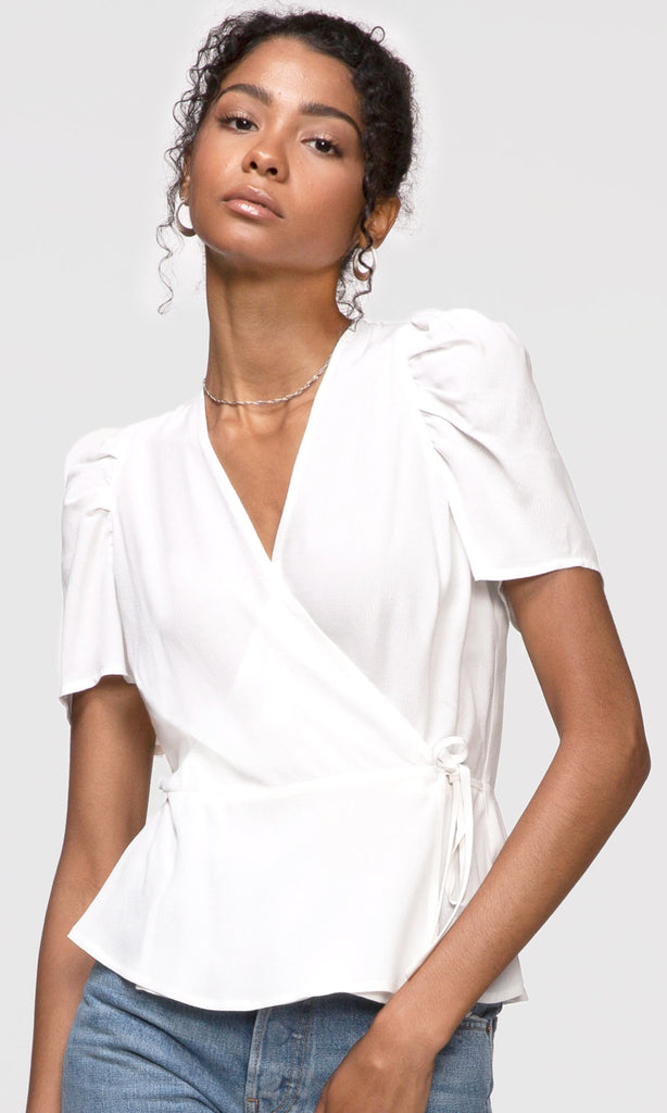 white pouf sleeve wrap top