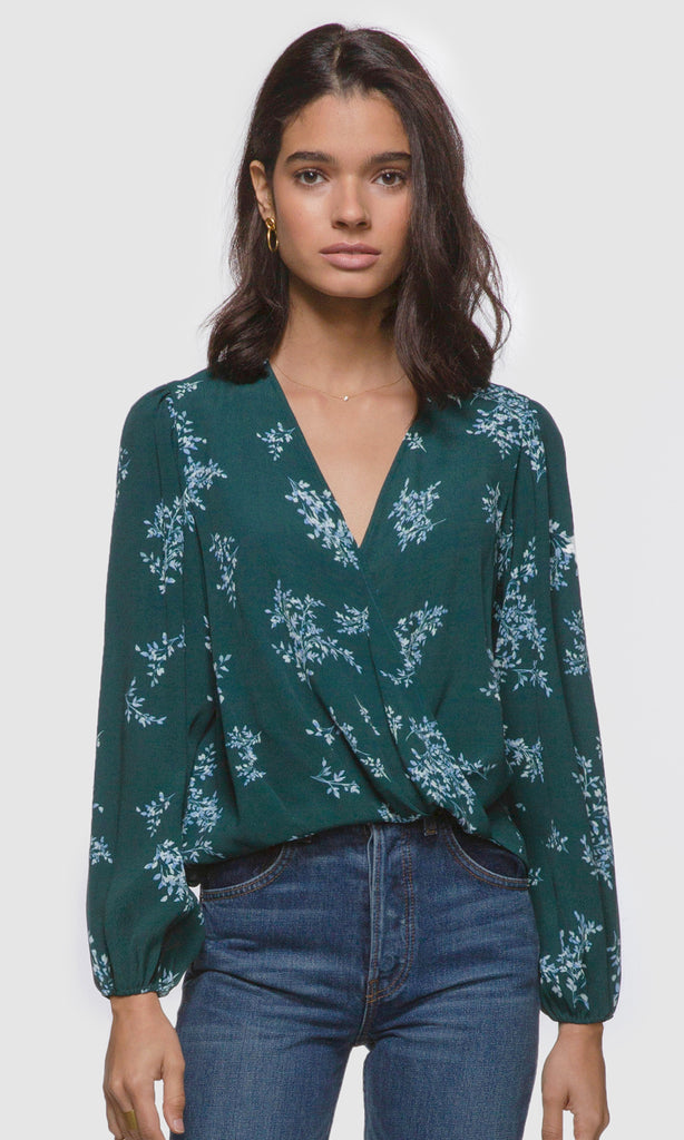 Women's green long sleeve wrap front floral blouse