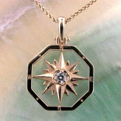 14K Yellow Gold Compass Rose Pendant with a Diamond Accent.