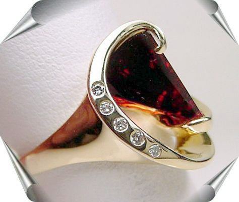 Lighthouse lens garnet and diamond ring