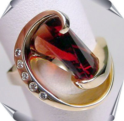 Lighthouse lens cut garnet and diamond ring