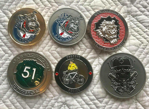 assorted TPS challenge coins