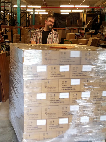 Patrick slingin pallets in the warehouse.