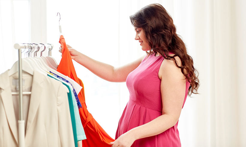 full figured woman holding dress up