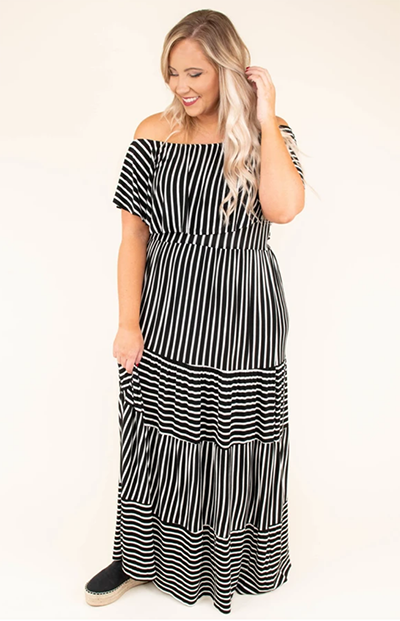 full figure woman in a maxi dress - striped