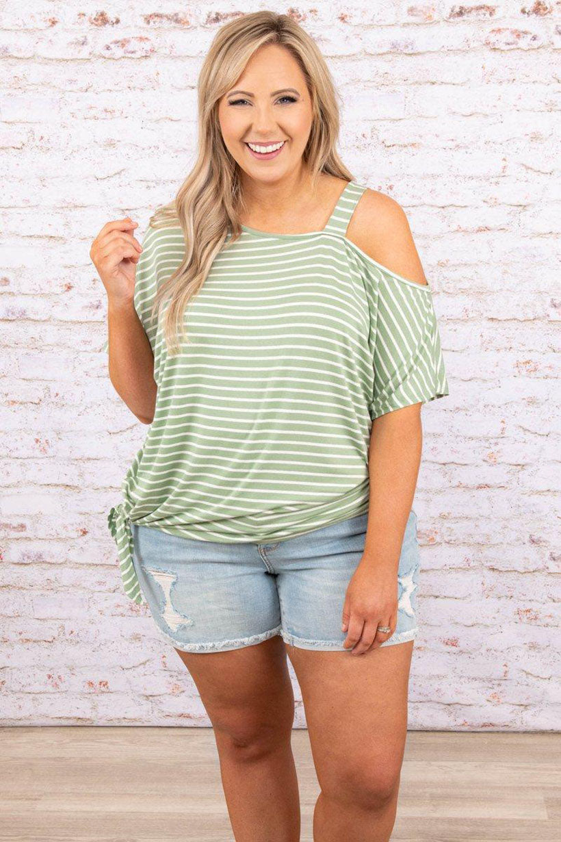 a full figured woman sporting getting to know you top in sage and ivory