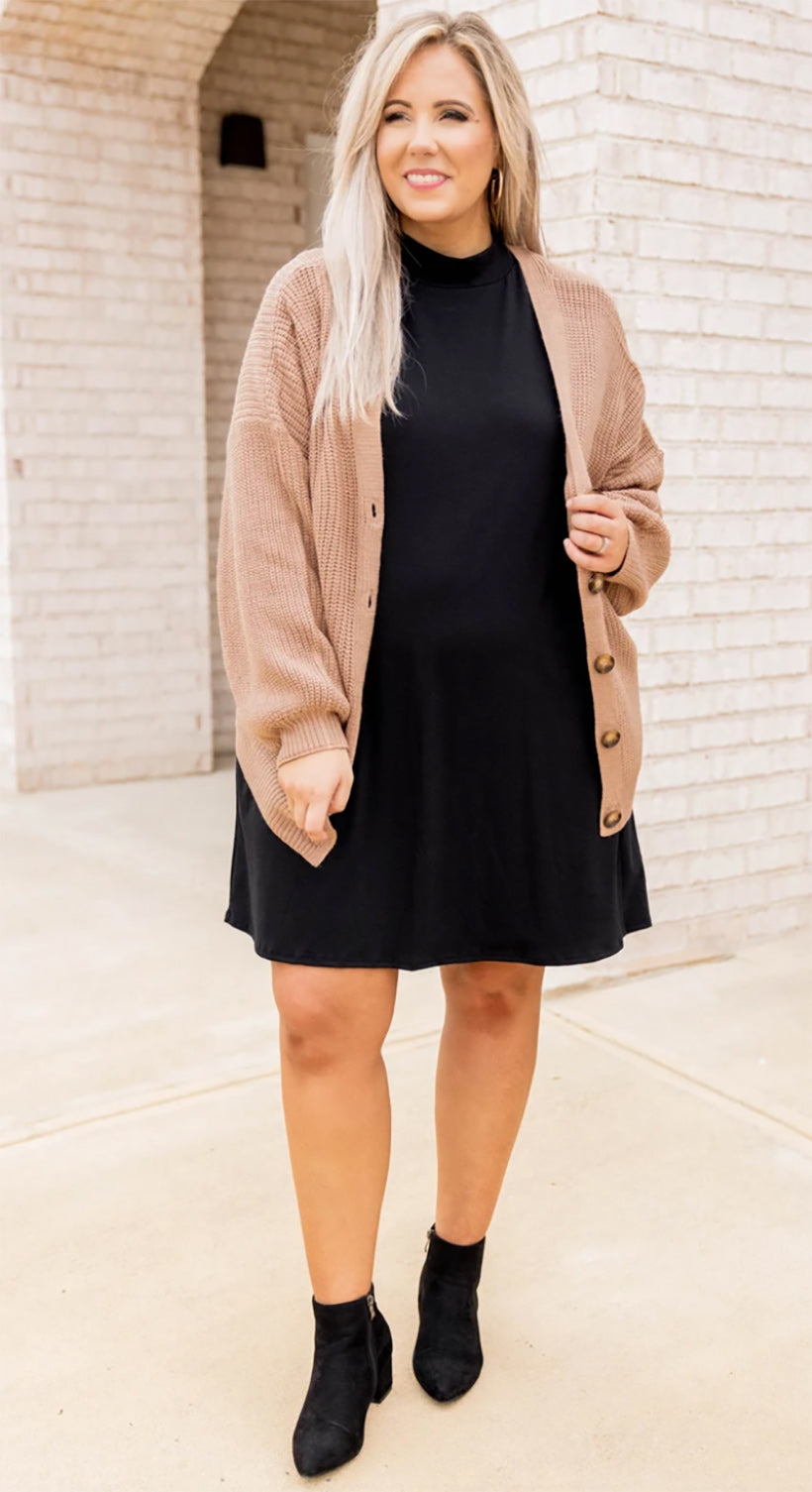 a full figured woman wearing a warm winters are coming cardigan mocha