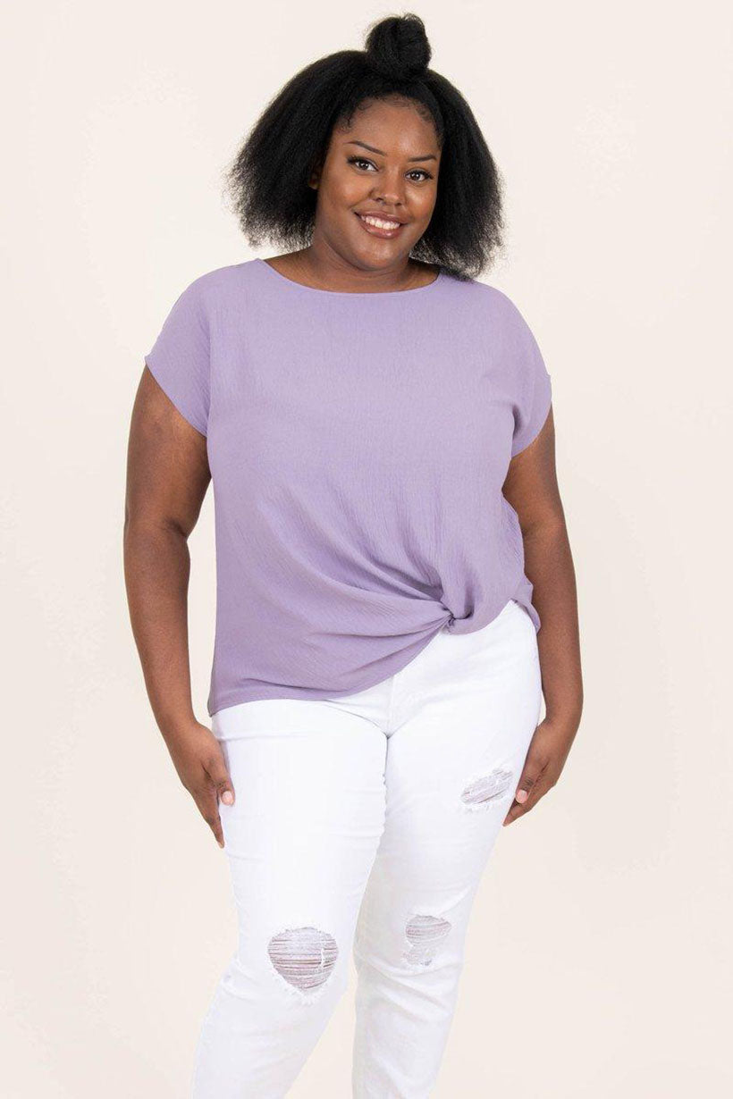 a full figured woman wearing second glancing top in lavender