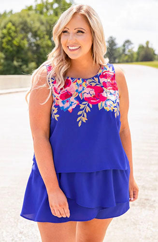 full sized woman wearing blue romper