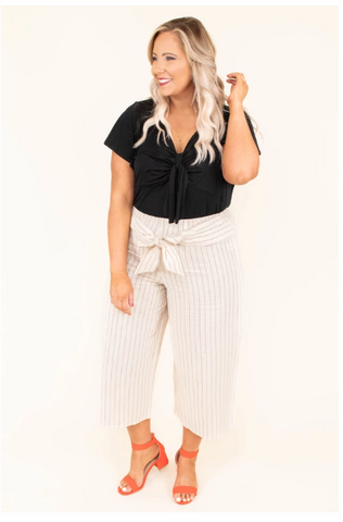 biege plus sized pants with black top