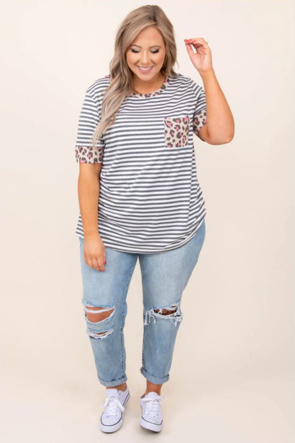 a smiling full figured woman modelling a pair of mood ring jeans in light wash