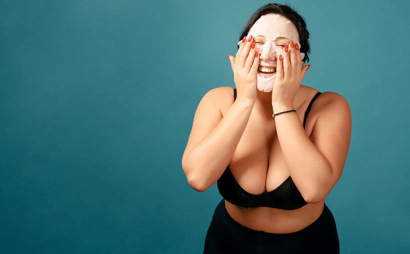 laughing plus sized woman wearing face mask