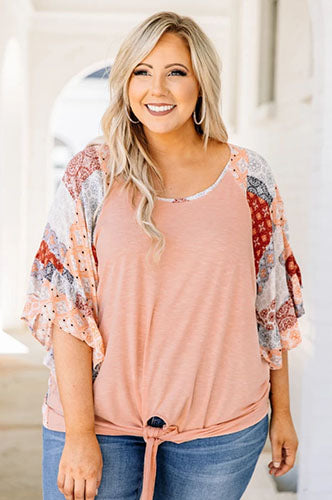 plus size woman in peach blouse