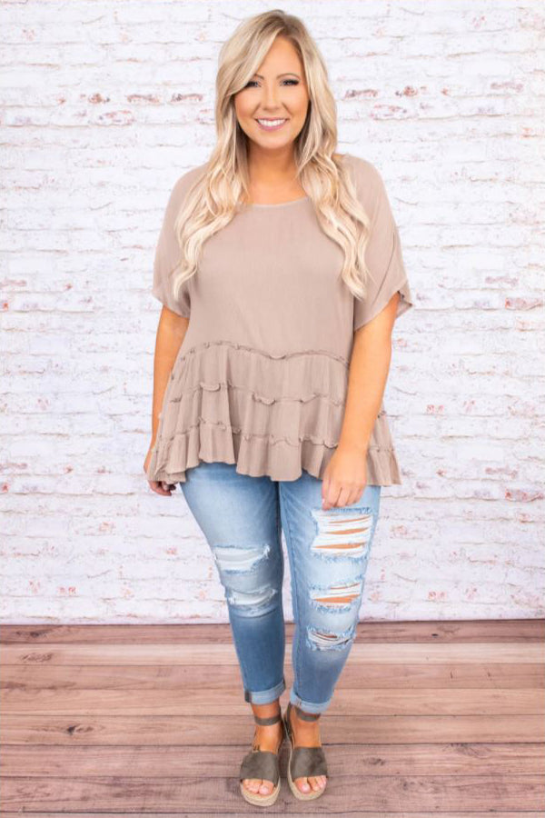 a full figured woman wearing a time for beauty top in taupe