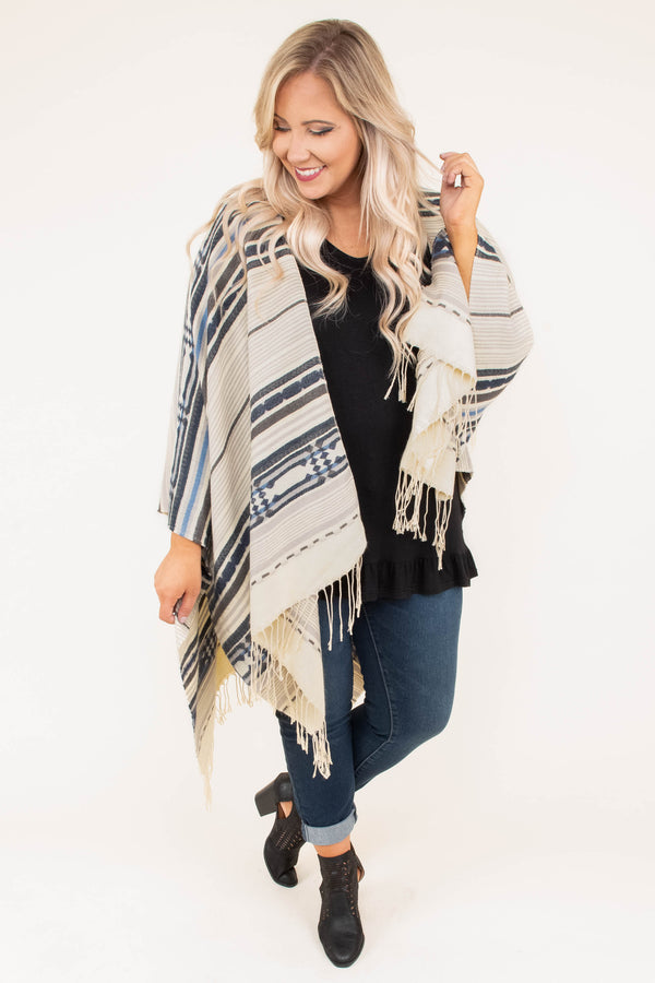 poncho, long sleeve, asymmetrical hem, open front, fringe, brown, gray, blue, striped, comfy, outerwear