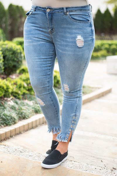 jeans, kinny, light blue, fringe hem, grommet details, rips, ankle length