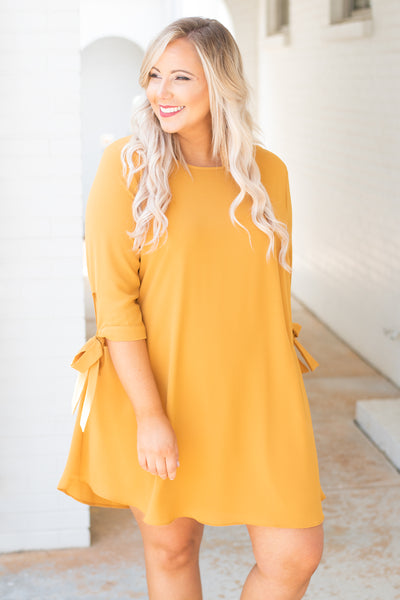 dress, short, three quarter sleeve, bow cuffs, curved hem, flowy, mustard, comfy