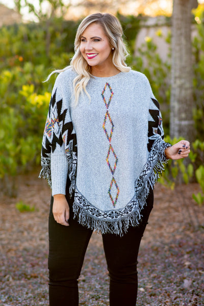 sweater, long sleeve, curved hem, fringe, poncho style, gray, stitched detail, geometric stitching, black, rainbow, comfy, outerwear, fall, winter