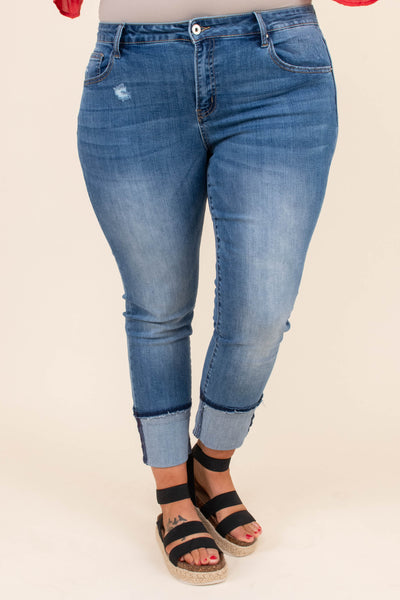 jeans, skinny jeans, medium wash, mild distressing , large cuffs