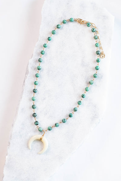 necklace, emerald beads, gold, tusk charm, short chain