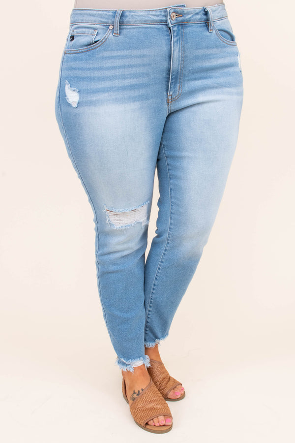 jeans, long, relaxed, light blue, faded, distressed hems, rips