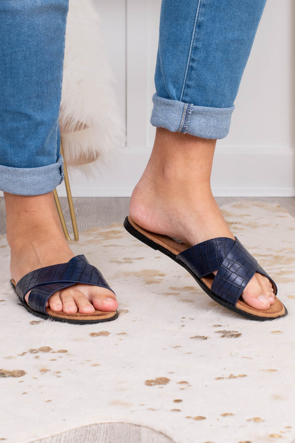 sandals, slide on, flat, open toe, open heel, crisscross straps, faux leather, snakeskin texture, navy