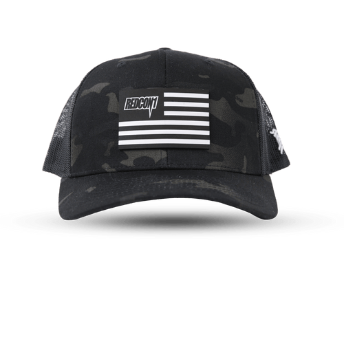 Black & White Flag Leather Patch On Dark Camo Trucker Hat