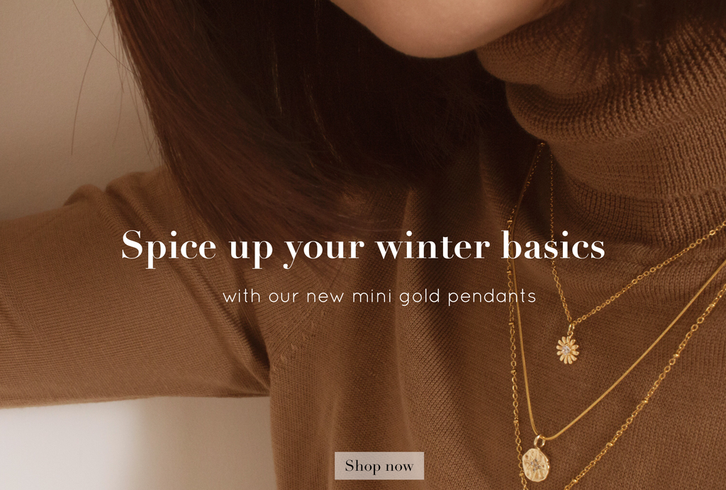 Spice up your winter basics with Cissy's gold pendants.