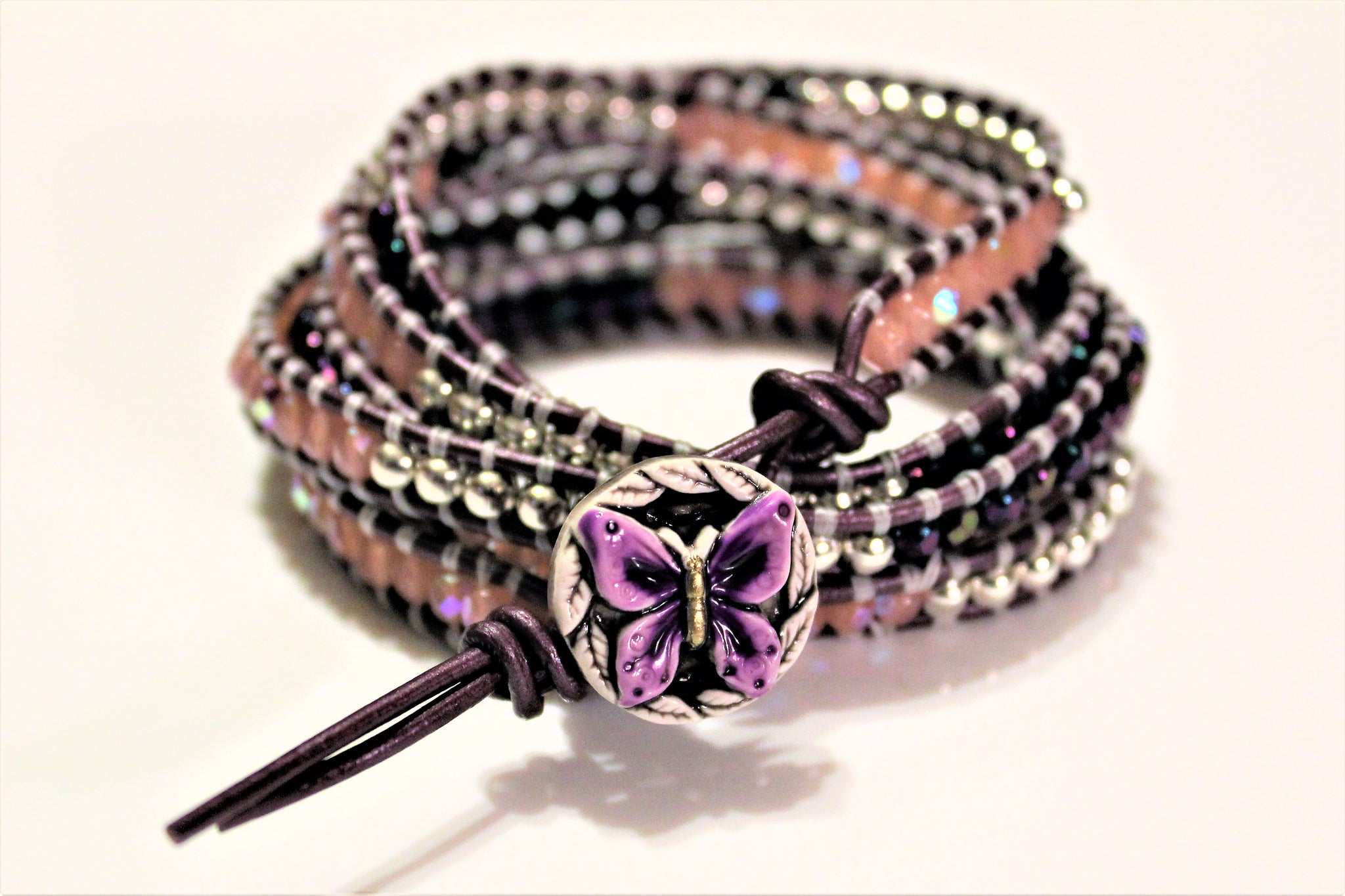 Wrap bracelets made of leather, crystals and beads.
