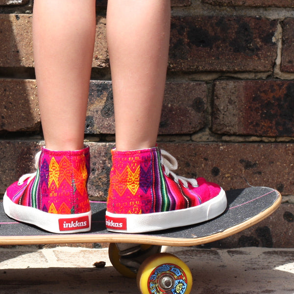 Inkkas cotton candy pink high top shoes available in Australia. Handmade fair trade bright pink shoes. An ethical and sustainable kids shoe. Inkkas Wholesome Gifts.