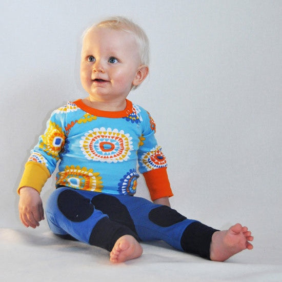 Certified organic baby and kids clothing. These baby pants / leggings with knee pads are soft and snug. Made in Sweden by Moromini. Organic Scandinavian kids fashion. Wholesome Gifts Australia.