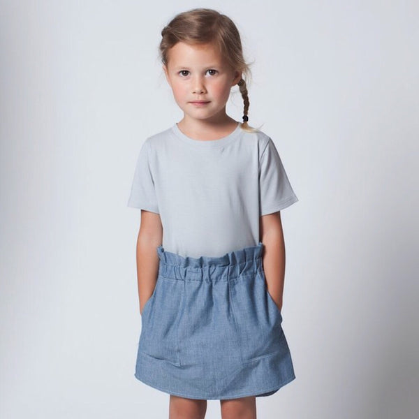 A sweet everyday summer skirt featuring side pockets and an elastic waist. ReCreate is an organic, fair trade fashionable kids brand with lots of unisex clothes. Wholesome Gifts Australia.