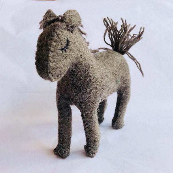 A darling handmade toy horse. Ethically made in Nepal from natural woollen felt. Wholesome Gifts Australia
