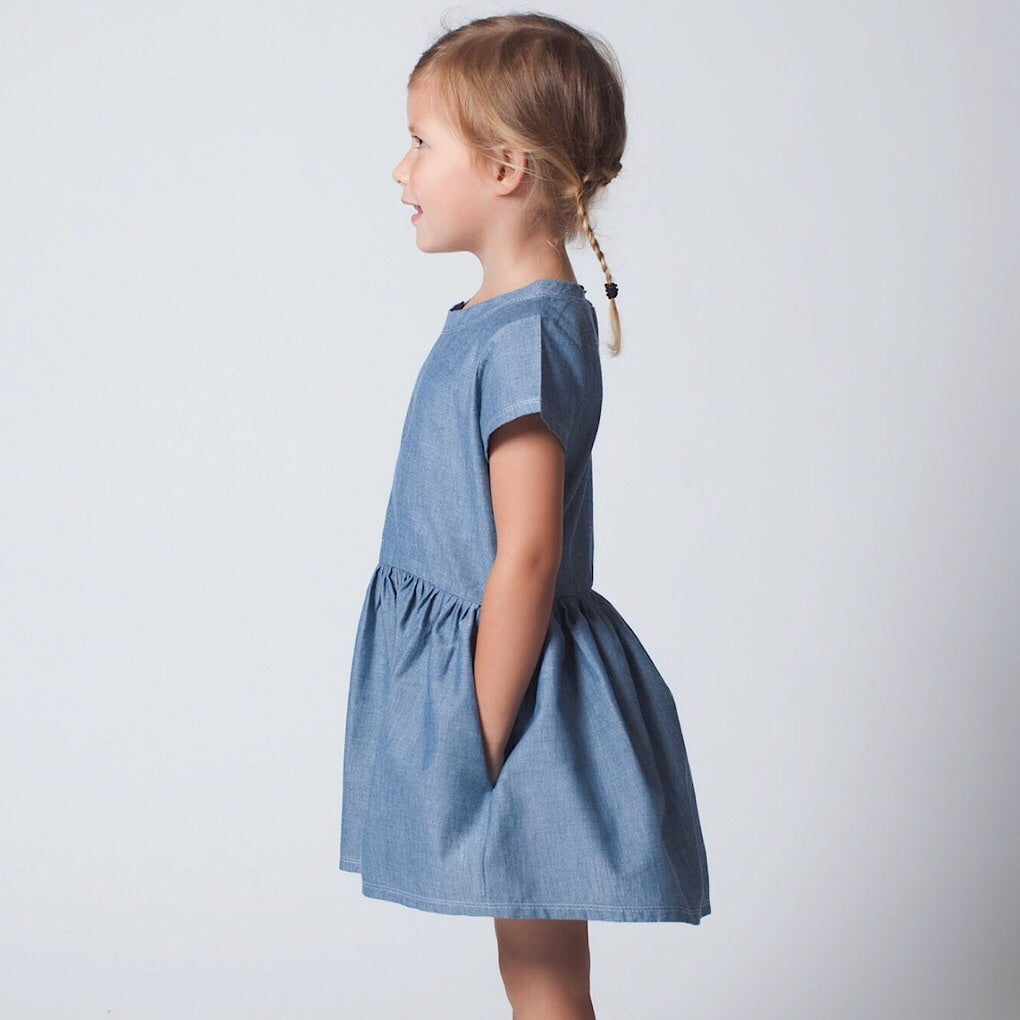 ReCreate clothing is ethically created in Cambodia, providing training, employment and opportunity for marginalised women. Chambray denim-style summer dress with capped sleeves. Wholesome Gifts Australia.