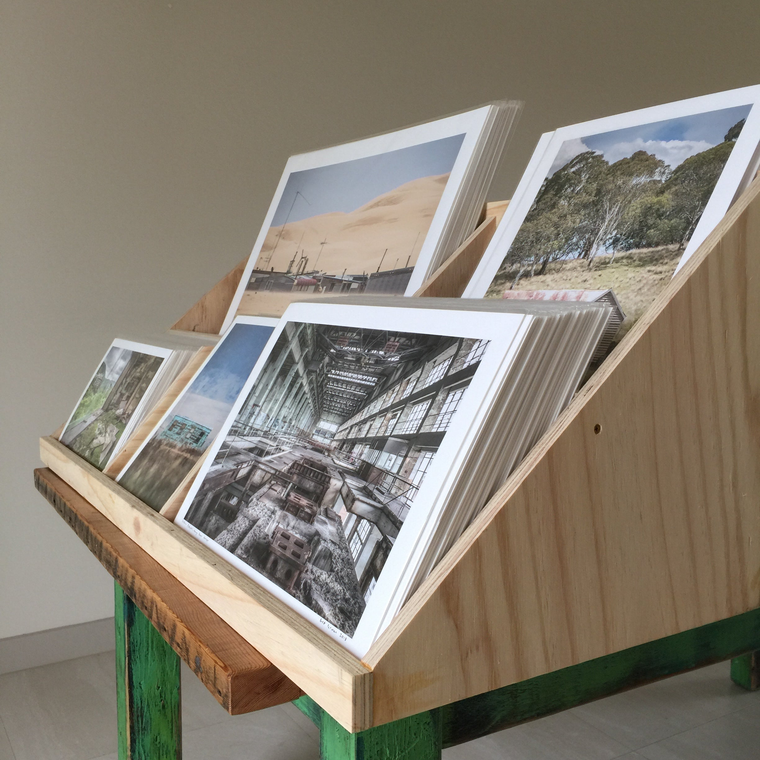 A timber crate full of Lost Collective prints.