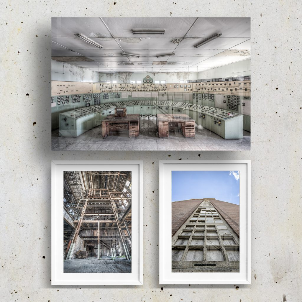 glass and framed lost collective prints on a concrete wall