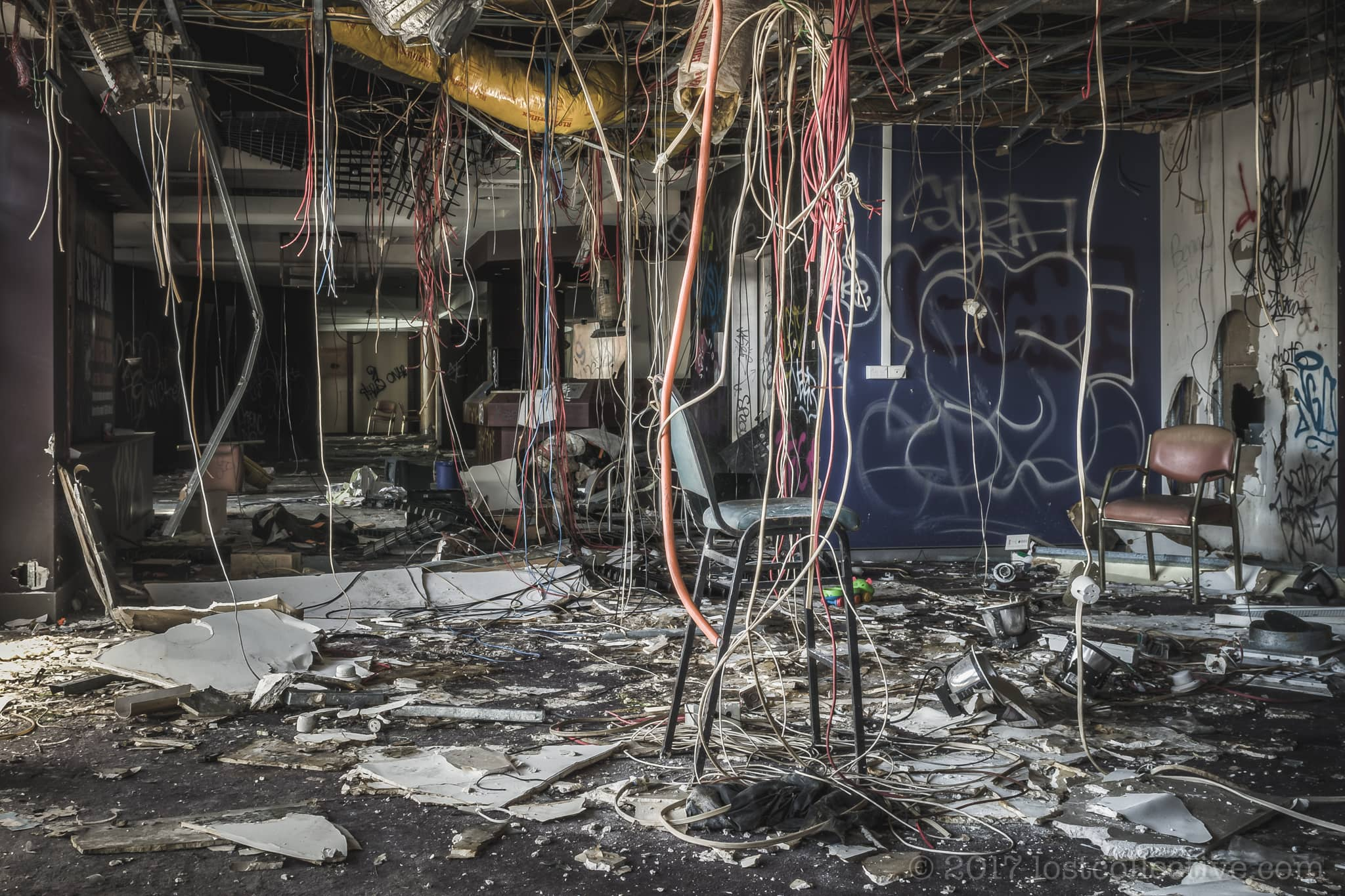 stripped cables hanging from the ceiling of the abandoned balmain leagues club - lost collective
