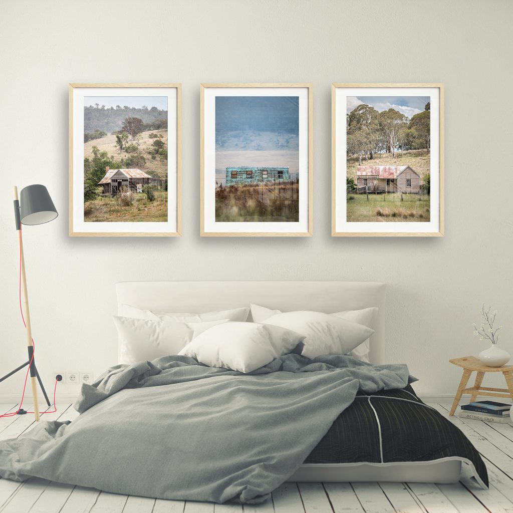 framed lost collective prints in a bedroom