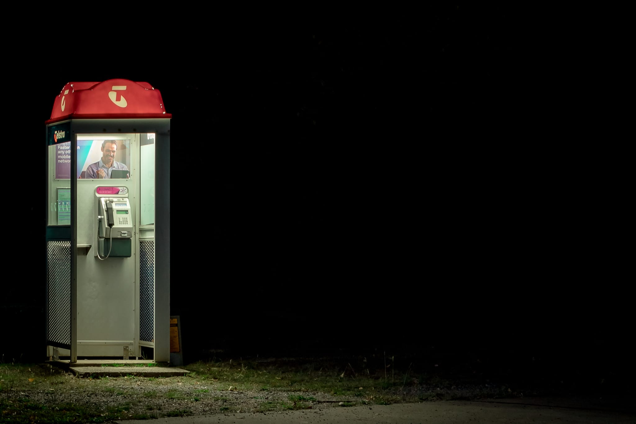 a phone booth in darkness - lost collective