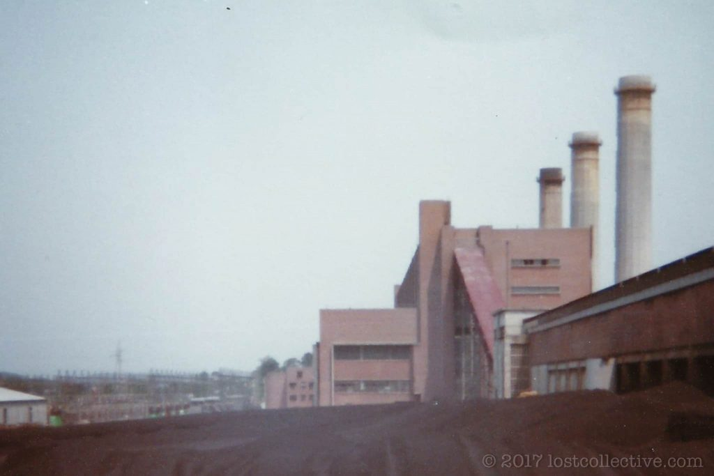 a shot from the coal stockpile of wangi power station towards the main building - lost collective