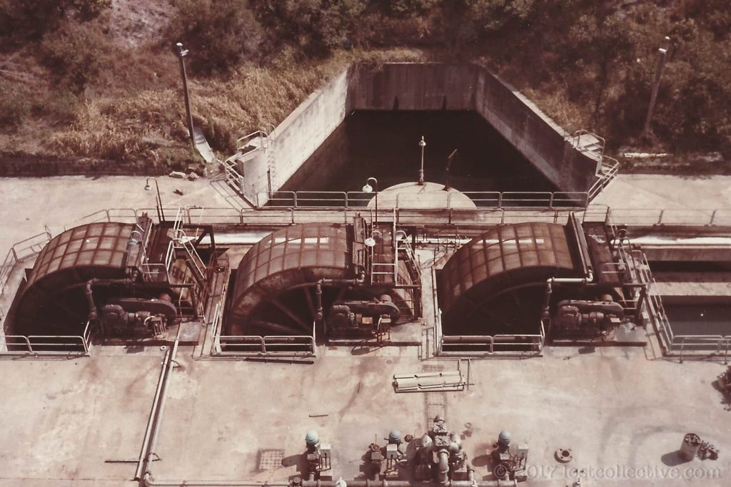 paddle wheels in the cooling water channel of wangi power station - lost collective