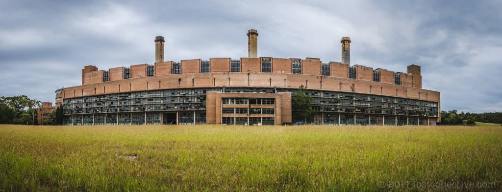 wangi power station across a grassy field - lost collective