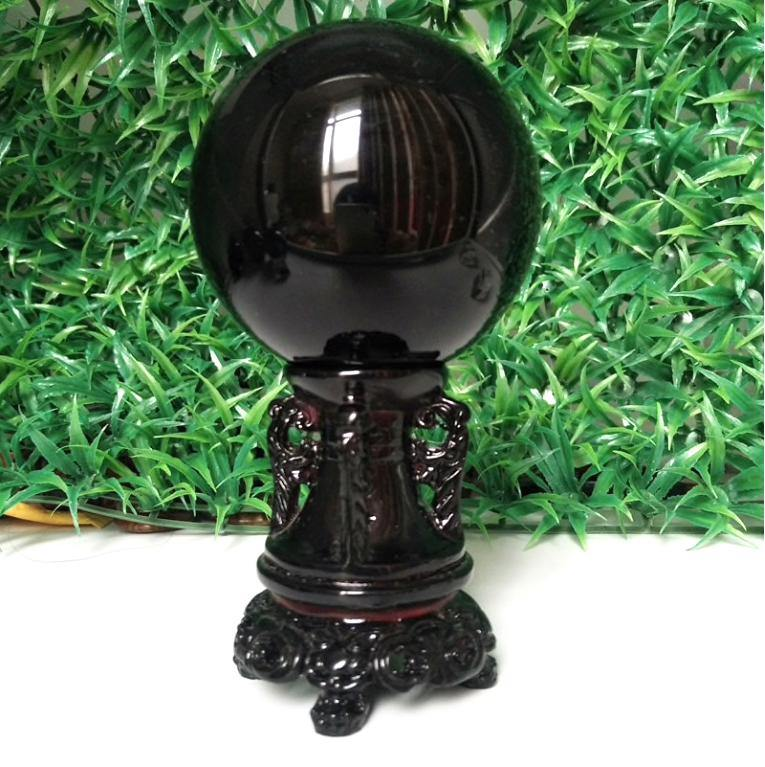 raw gemstone, crystal ball, onyx, obsidian crystal ball, ornate sculpture, black, home decor, interior design, la maison rebelle, gift shop, los angeles