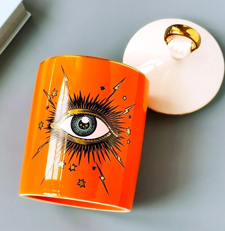 seeing eye jar, evil eye canister, storage jar, home storage, makeup organizer, decorative jar, home decor, interior design, la maison rebelle, porcelain, ceramic, glass jar, blue jar, orange, gold