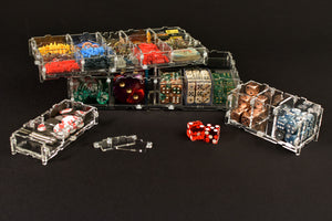Crystal Fortress Storage Pods stacked onto of one another filled with dice, tokens, and gaming accessories.