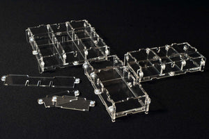 Modular acrylic display case pods for miniatures or models