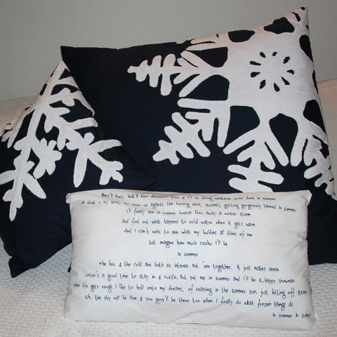 Handmade frozen themed cushions with snowflakes and lyrics