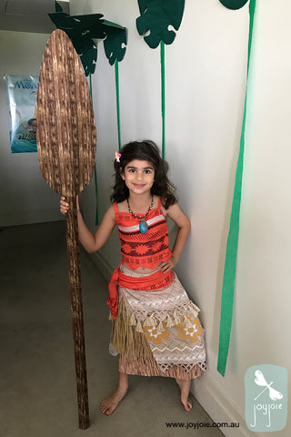 Girl in Moana costume with handmade oar