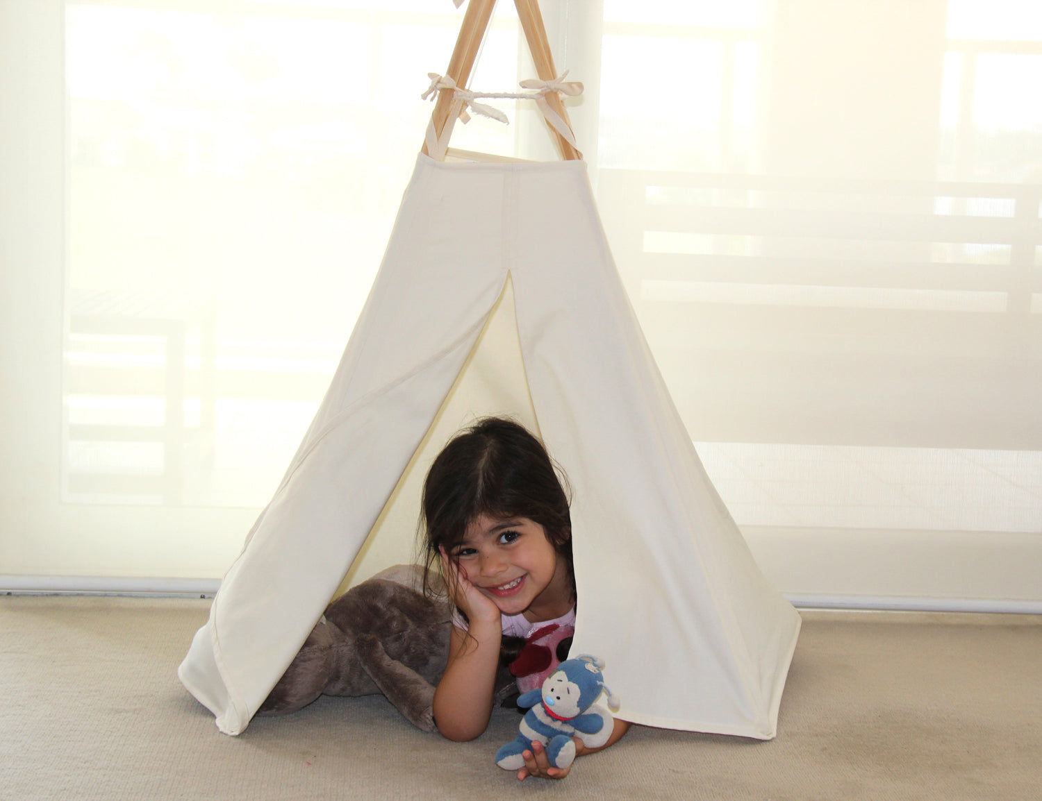 Child inside a pet teepee
