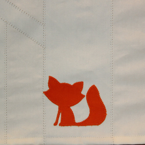 Cheekly fox on tepee